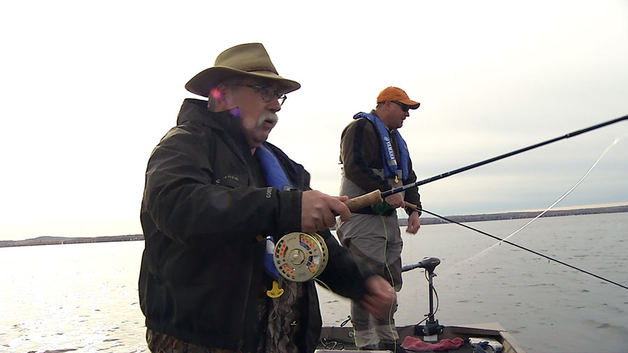 Phil Rowley and Michael Short dipping a fishing line