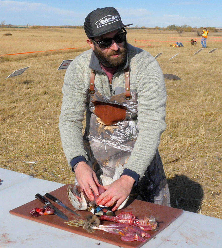 Chef Cam Dobranski field preps two pheasants for a recipie