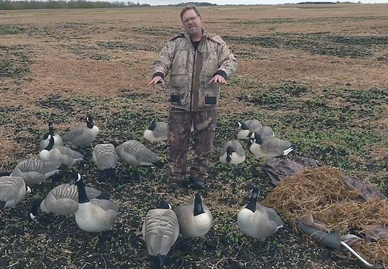 Brad Fenson surrounded by goose decoys