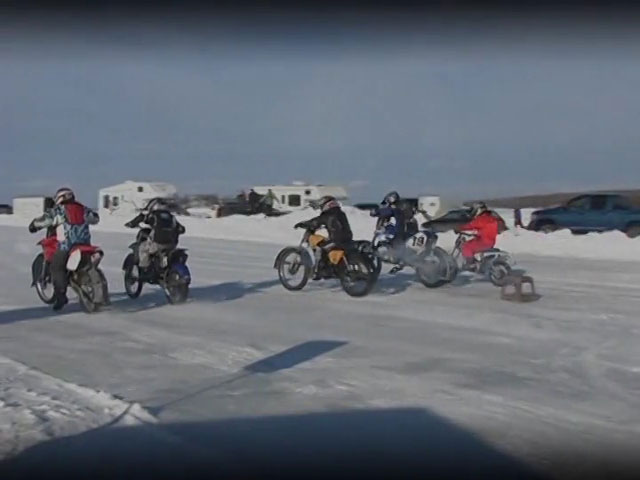The motorcyle ice racers are off