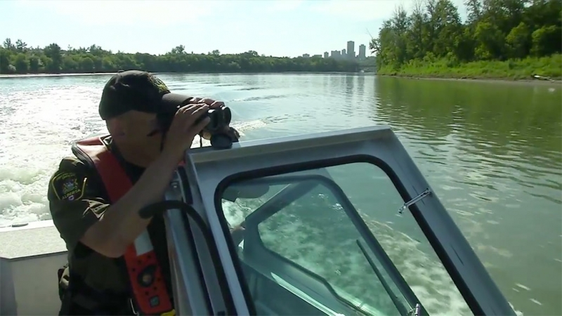 Patrolling the North Saskatchewan river near Edmonton with conservation officers