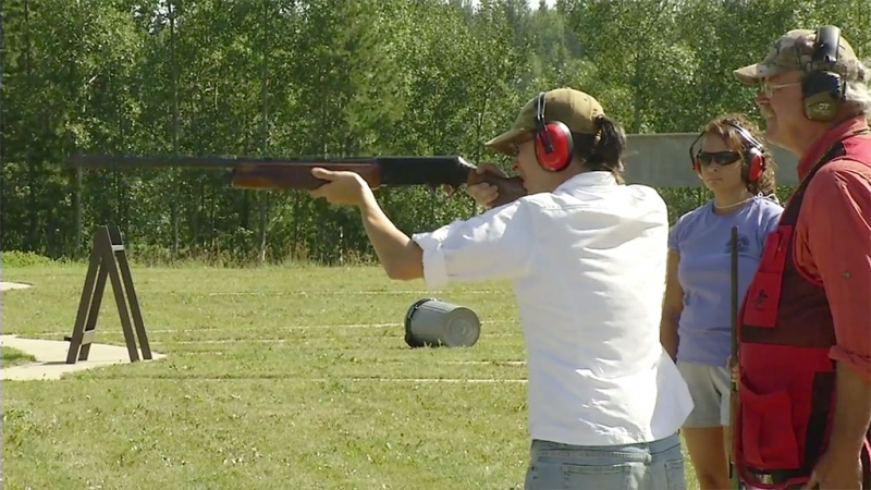 Shooting clay pigeons at the Outdoor Women's Program at Alfred Lake