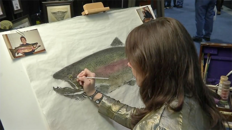 Mya DeRyan demonstrating the art of fish rubbing