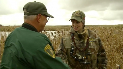 Mary encounters Fish & Wildlife Officer while hunting