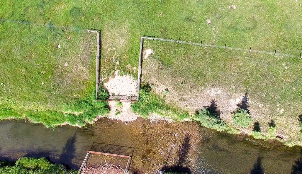 Aerial view of a newly installed gate system in a stream bank fencing project on the North Raven river